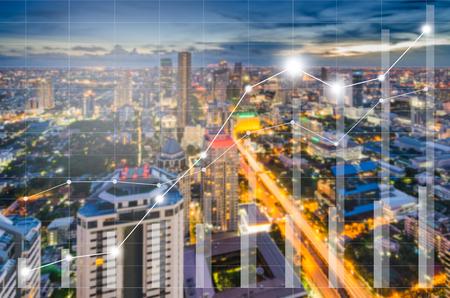 Foto de Conceptual of business image with financial charts and graphs on blur cityscape as background, vintage style process - Imagen libre de derechos