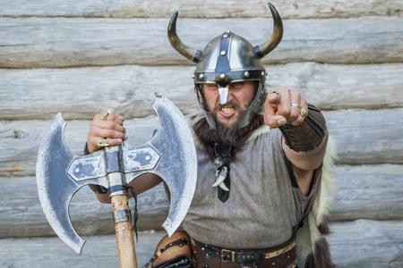 Foto de Portrait of the angry viking looking and pointing at camera. - Imagen libre de derechos