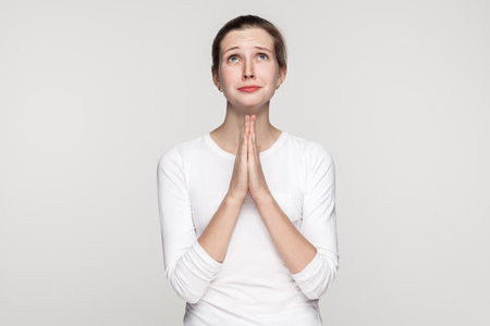 Photo for Religion concept. Prayer girl. Studio shot,isolated on gray background - Royalty Free Image