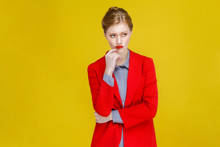 Photo pour Thoughtful confident business woman thinking. Studio shot, isolated on yellow background - image libre de droit