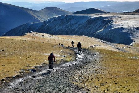 A group of mountain bikers near the summit of Helvellyn, in the English Lake District