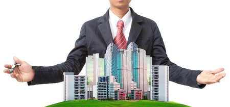 Foto de business man and modern building on green grass field use for land management theme - Imagen libre de derechos