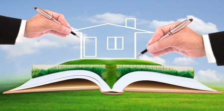 Foto de business man writing new house on beautiful green field use for multipurpose - Imagen libre de derechos