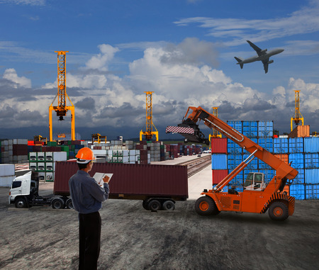 Foto de officer man working in land transport logistic with container dock scene use for import export world trading cargo theme - Imagen libre de derechos