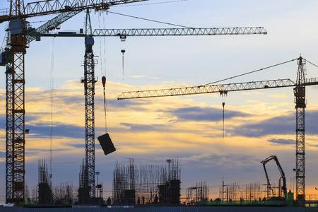 Foto de crane of building construction against beautiful dusky sky - Imagen libre de derechos
