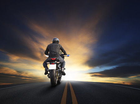 Photo pour young man riding big bike motocycle on asphalt high way against beautiful dusky sky use for biker traveling and journey theme - image libre de droit