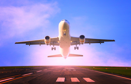 Photo for passenger jet plane flying from airport runway use for traveling and cargo ,freight industry topic - Royalty Free Image
