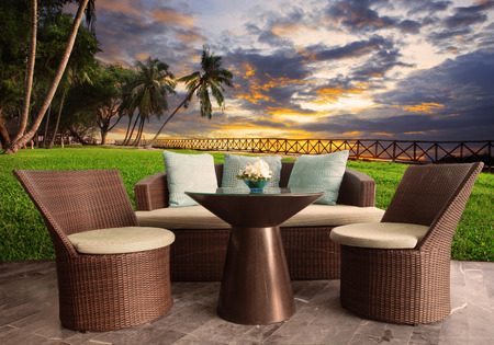 Foto de rattan chairs in outdoor terrace living room against beautiful sunset sky - Imagen libre de derechos