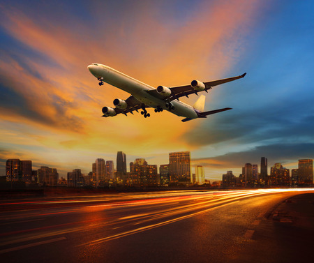 Foto de beautiful lighting of vehicle in land transportation and passenger jet plane flying above urban scene use for transport business and people traveling theme - Imagen libre de derechos