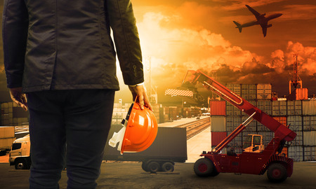 Photo pour working man in container dock and land ,air transport ,import export logistic cargo freight and shipping commercial service industry - image libre de droit