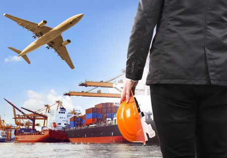 Photo for working man and commercial ship on port and air cargo plane flying above use for water and air transport,logistic import export industry - Royalty Free Image