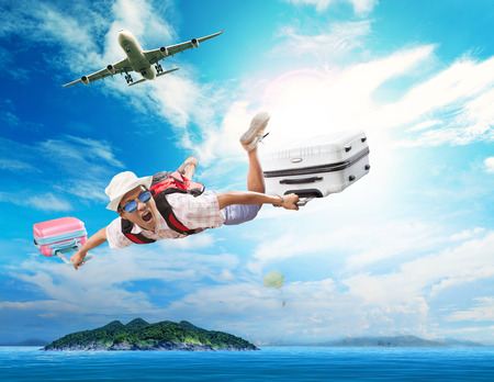 Photo pour young man flying from passenger plane to natural destination island on blue ocean with happiness face emotion use for people traveling on vacation holiday in summer season - image libre de droit