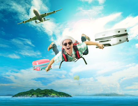 Foto de young man flying from passenger plane to natural destination island on blue ocean with happiness face emotion use for people traveling on vacation holiday in summer season - Imagen libre de derechos