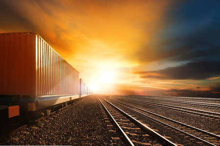 Photo pour industry container trains running on railways track against beautiful sun set sky use for land transport and logistic business - image libre de droit