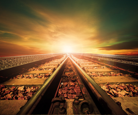 Photo for junction of railways track in trains station agains beautiful light of sun set sky use for land transport and logistic industry background ,backdrop,copy space theme - Royalty Free Image
