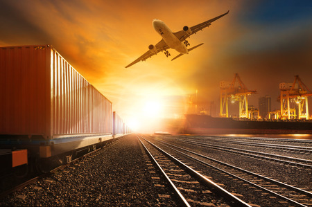 Photo pour industry container trainst running on railways track and commercial ship in port ,plane air cargo flying above  use for land ,air ,and vessel transport industry  and logistic business - image libre de droit