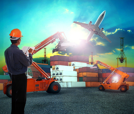 Photo pour working man in logistic business working in container shipping yard with dusky sky and jet plane cargo flying above use for land to air transport and freight - image libre de droit