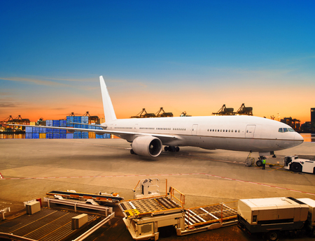 Foto de air freight and cargo plane loading trading goods in airport container parking lot use for shipping and air transport logistic industry - Imagen libre de derechos
