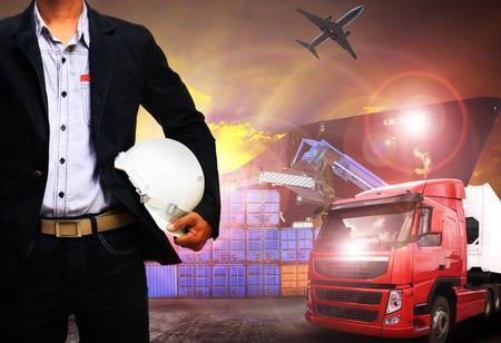 Foto de working man in shipping port,freight cargo ,logistic and import,export business - Imagen libre de derechos