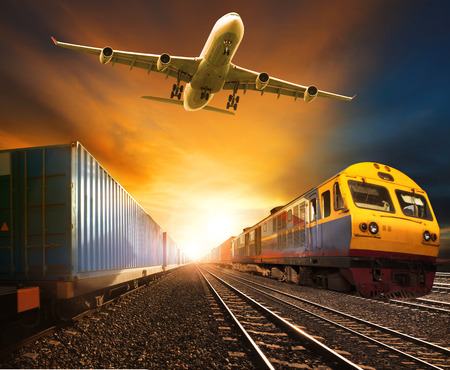 Foto de industry container trainst running on railways track and cargo freight plane flying above against beautiful sun set sky use for land transport and logistic business - Imagen libre de derechos