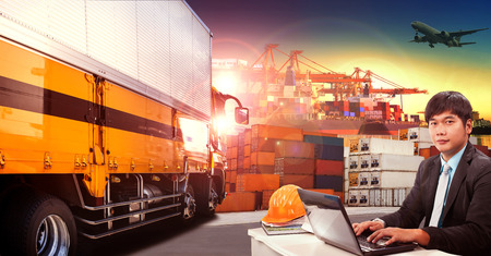 Foto de working man and container truck in shipping port ,container dock and freight cargo plane flying above use for transportation and logistic indutry - Imagen libre de derechos