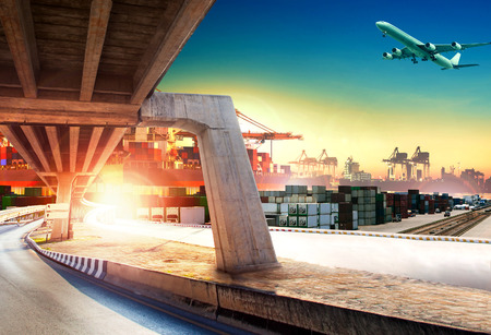 Photo pour land transport run into shipping port and container dock with freight cargo plane flying above - image libre de droit