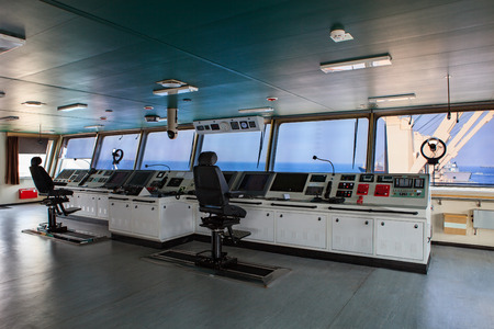 Foto per wheelhouse control board of modern industry ship approaching to harbor - Immagine Royalty Free
