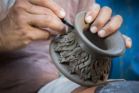 Photo pour close up potter artist working on clay pottery sculpture fine art in thailand - image libre de droit