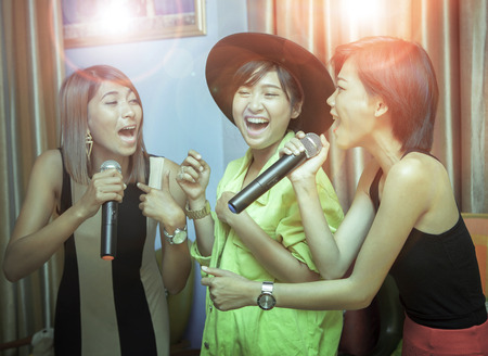 Photo for asian younger woman singing karaoke with relaxing and happiness emotion - Royalty Free Image