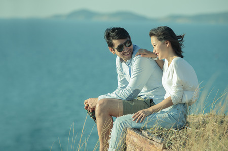 Photo for portrait of asian younger man and woman relaxing vacation at sea side happiness emotion - Royalty Free Image