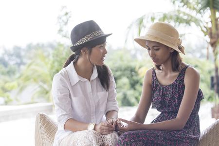 Photo pour portrait of asian younger woman friend serious talking  - image libre de droit