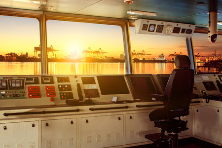 Photo for wheelhouse control board of modern industry ship approaching to harbor at night - Royalty Free Image