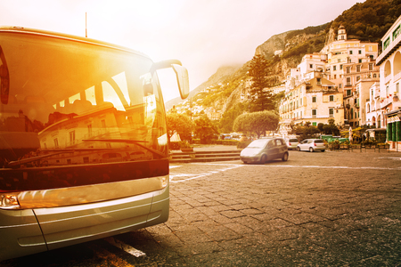 Foto per tourist bus parking on town square of amalfi coast most popular traveing destination in south italy - Immagine Royalty Free