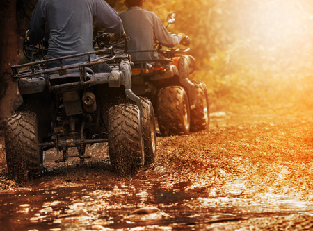 Foto per man riding atv vehicle on off road track ,people outdoor sport activitiies theme - Immagine Royalty Free
