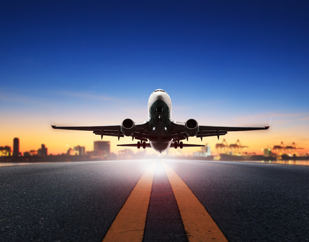 Photo pour cargo plane take off from airport runways against ship port background - image libre de droit