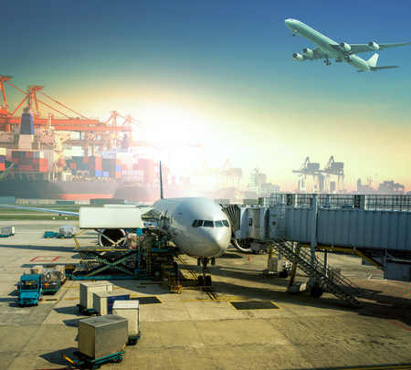 Foto per cargo plane loading commercial goods against large logistic ,shipping port background - Immagine Royalty Free