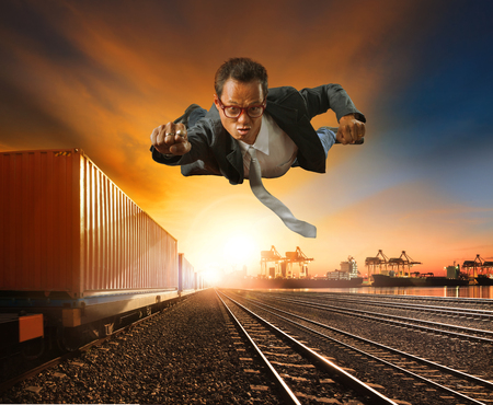 Foto per business man flying against logistic industry background - Immagine Royalty Free