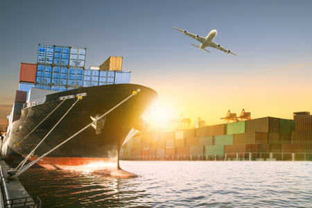 Foto per ship and container box and cargo plane flying over shipping dock use for logistic and international transportation - Immagine Royalty Free
