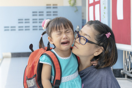 Foto de children and mother crying first day go to pre-kindergarten school - Imagen libre de derechos
