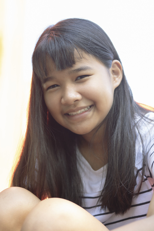 Foto de close up face of forelocik hair asian teenager toothy smiling face happiness emotion - Imagen libre de derechos