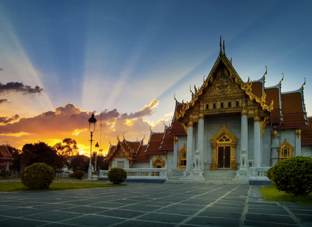 Photo for beautiful sunset sky and at wat benchamabophit ,marble temple one of most popular traveling destination in heart of bangkok thailand capital - Royalty Free Image
