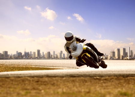 Photo pour man wearing safety suit riding sport racing motorcycle on sharp curve highway  - image libre de droit