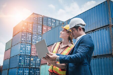 Foto per Business Team Container Cargo Shipping Control Inspection Loading Dock and Management Import/Export Freight at Port Ship Yard. Manager and Foreman Teamwork Inspecting Containers Shipment Warehouse. - Immagine Royalty Free