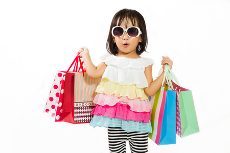 Photo for Asian Chinese little girl with shopping bag in white isolated background. - Royalty Free Image