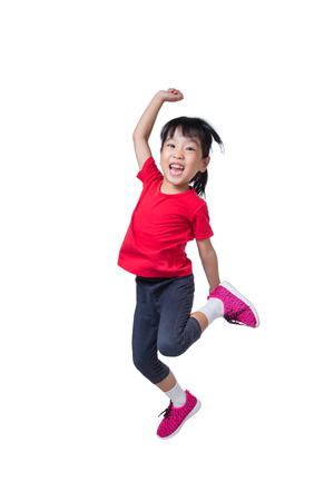 Photo pour Asian Chinese little girl jumping up and wave her hands in isolated white background - image libre de droit