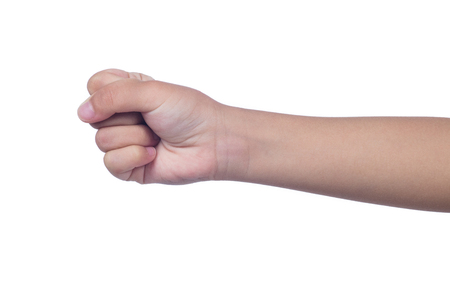 Foto de Close up of a child's clenched fist in isolated white background - Imagen libre de derechos