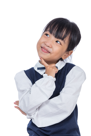 Foto de Portrait of Asian Little Chinese Girl thinking with finger on chin in isolated White Background - Imagen libre de derechos