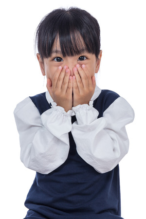 Photo for Asian Little Chinese Girl covering her face in isolated White Background - Royalty Free Image