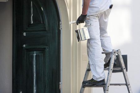 Photo pour Close-up of a professional house painter with paint and brush - image libre de droit