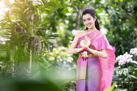 Photo for Beautiful Thai girl in Thai traditional costume - Royalty Free Image